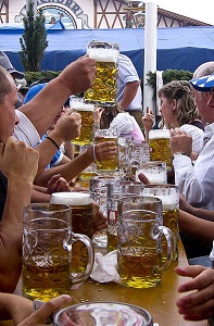 People enjoying large glasses of beer